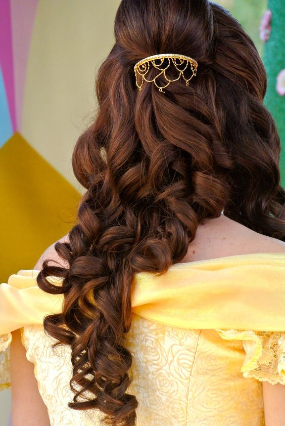 The classic hair was more elegant and timeless, I'm not overly fond of all of the curls (it kind of looks like prom hair to me?) I definitely prefer the delicate golden ornament to that huge yellow thing Belle used to wear though, so the hair isn't a TOTAL loss <3