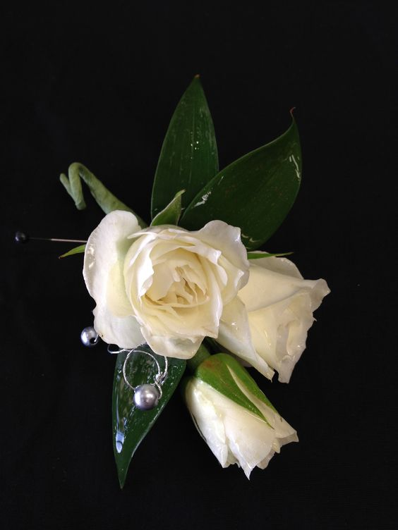 Boutonniere with white spray roses