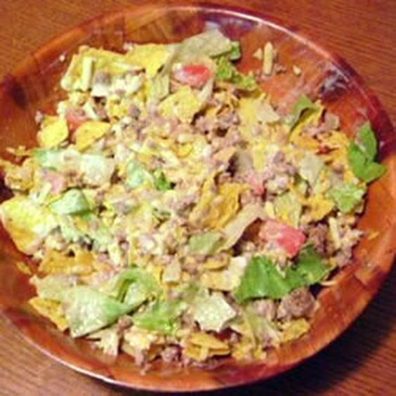 Sue's Taco Salad Recipe Salads, Main Dishes with lean ground beef, taco seasoning mix, tortilla chips, shredded cheddar cheese, kidney beans, ranch dressing, tomatoes, lettuce, green onions