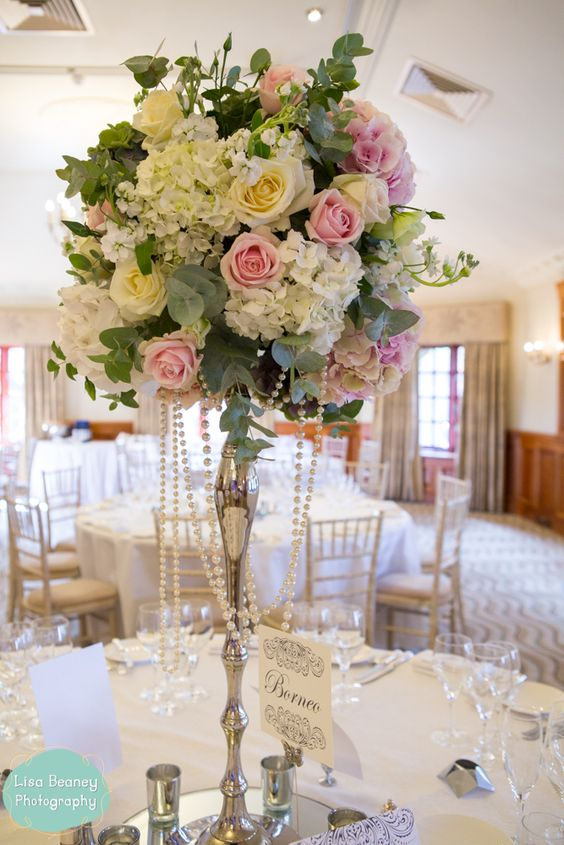 Opulent ivory and blush wedding flowers tall centrepieces