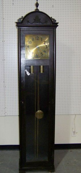 "COLONIAL MFG CO Longcase Grandfather Clock: CA 1972 in Zeeland, MI. Model 1302, Serial Number 710153. Clock has Metal Face with Raised Arabic Numerals, Handpainted Moon Phase Dial. Westminster Chime. German 3 Weight, 8 Day Time Movement. 82""T. (900-1200)"