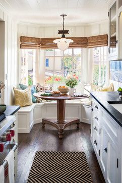 Take a tour of this charming beach cottage with a built-in breakfast nook with bay window.