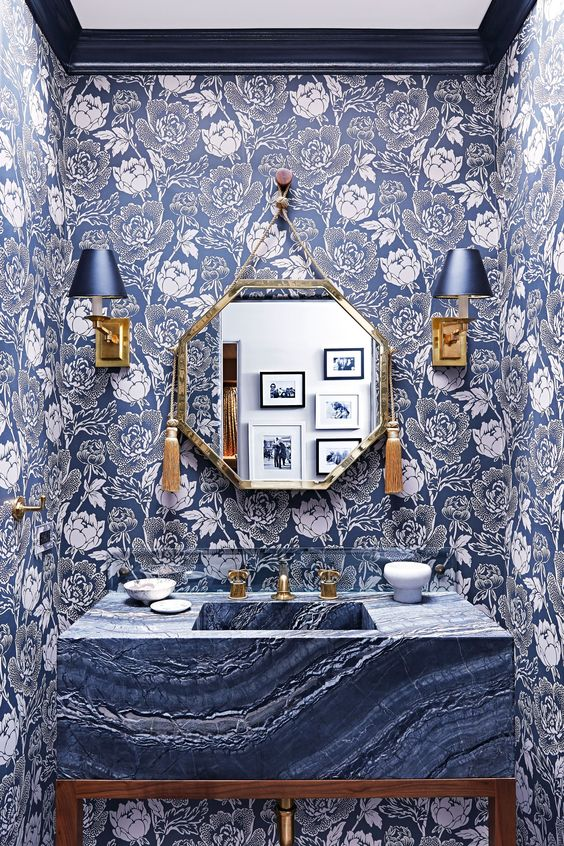 Peony wallpaper lines the walls of this color-happy powder room. | archdigest.com: