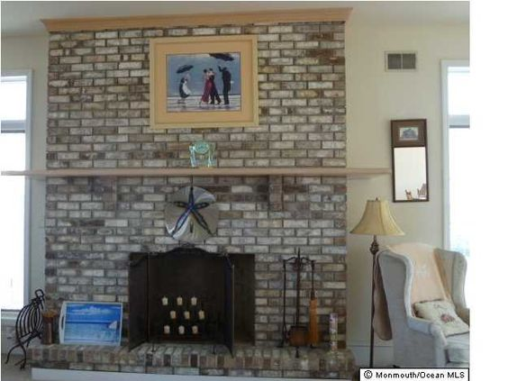 A fireplace with a view of the ocean in the background!!  Avon-by-the-sea