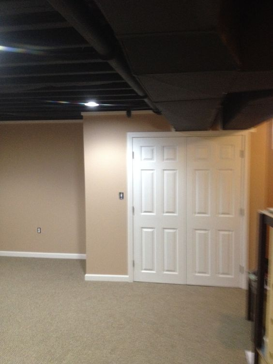 This Exposed Basement Ceiling Was Spray Painted Black Due To The Duct Work  And Pipes To Create A Visually Higher Ceiling. This Was A Great Idea When  Youu0027re ...