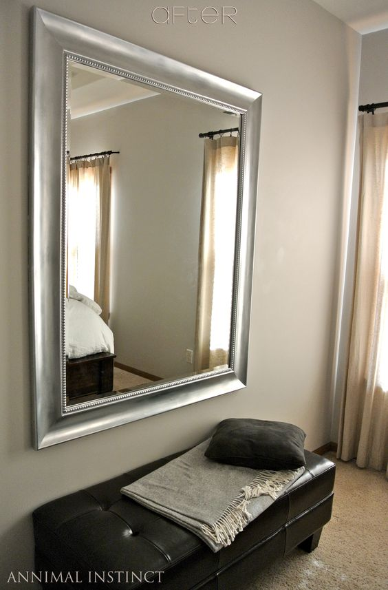 Definitely could do this to our mirror over the couch for the next home.  DIY paint job:  Black mirror frame painted silver & topped with rub 'n buff.  Looks like Restoration Hardware at fraction of cost! (for giving a more relaxed look to the master bedroom)