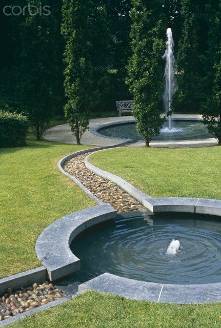 Circular pond with water rills adjoining ponds pond for Circular garden ponds