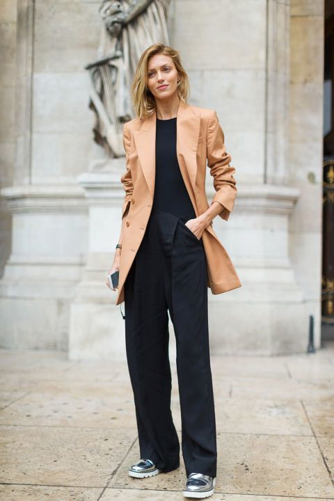 A smart casual combination of a camel double breasted blazer and black wide leg pants can maintain its relevance in many different circumstances. Silver leather loafers will add a new dimension to an otherwise classic look.   Shop this look on Lookastic: https://lookastic.com/women/looks/tan-double-breasted-blazer-black-crew-neck-t-shirt-black-wide-leg-pants/21604   — Tan Double Breasted Blazer  — Black Crew-neck T-shirt  — Black Wide Leg Pants  — Silver Leather Loafers