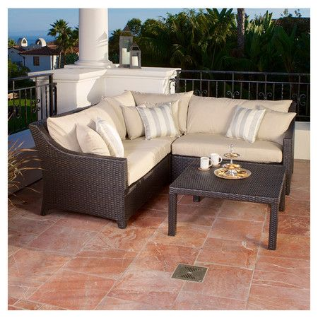 Eco-friendly outdoor seating group with overstuffed Sunbrella accent pillows and fade-resistant cushioning. Includes a three-piece sectional sofa and coffee ...