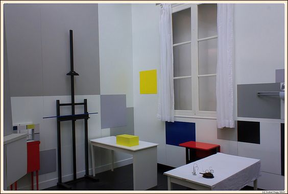 "Mondrian's studio photographed by Isabel Fagg. Nicholson first met Mondrian in 1934 when he visited his all-white Paris studio and was so bowled over he had to sit down at a cafe table to recover. It was such a tranquil, peaceful space, he wrote reverently in his journal, and had an atmosphere like ""one of those hermit's caves where lions used to go to have thorns taken out of their paws""."