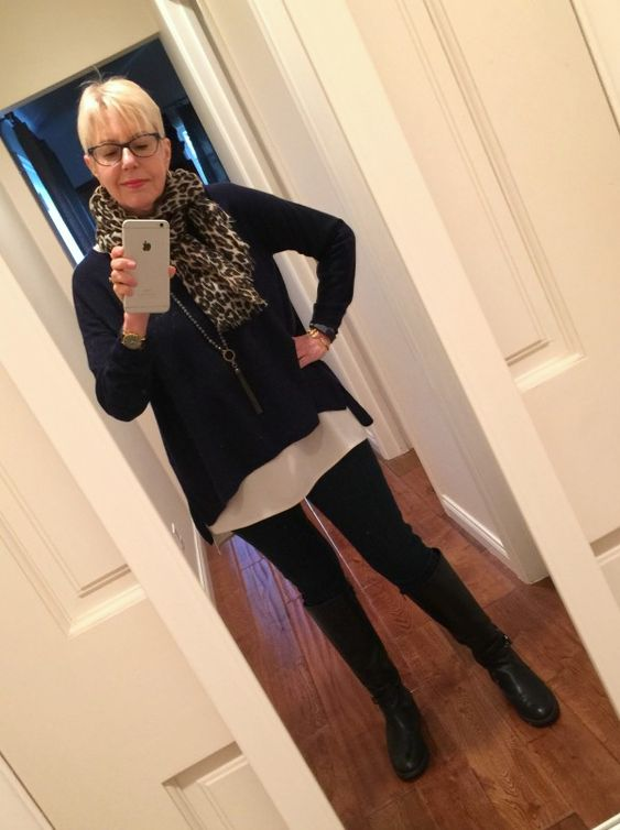 rainy day outfit: leopard scarf, cashmere sweater over tunic, knee boots