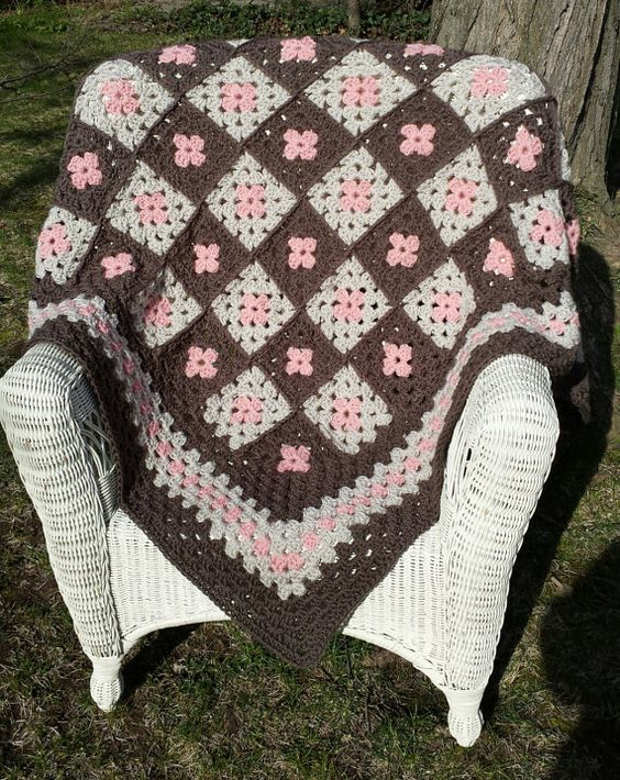 This throw makes a perfect gift! Made with super-soft acrylic yarn, its very warm and cozy. A nice decorative accent, and also perfect for afternoon naps. Measures 57 L by 47 W. Can be machine washed, but hand washing is recommended.