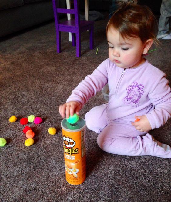 Pom pom push into a Pringles container