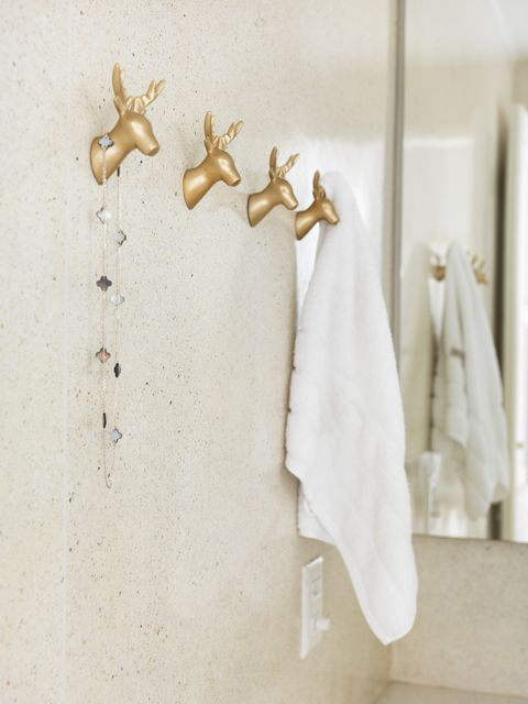 Deer towel holders! @Melissa Hoffman-Long, I am thinking that Nick would LOVe this.