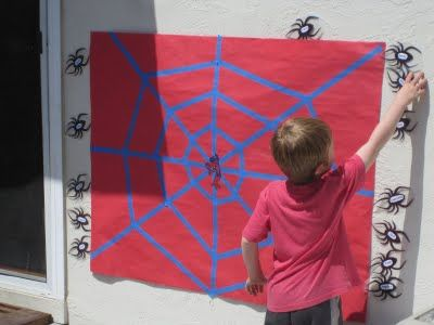 Pin the spider on the web game -  love this!!  Planning a party? Visit www.candlesandfavors.com for personalized invitations, thank you notes and party favors! Hundreds of themes available!!!