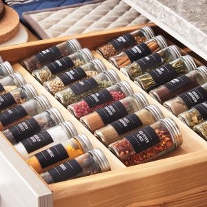 Spices-A single layer is the goal, so you can see what you have. These low racks for drawers fit jars of various sizes. We decanted spices into clear jars and added clip-art labels.