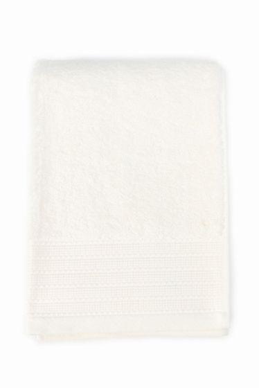 ELVANG バスタオル クリーム 70140  ELVANG バスタオル クリーム 70140 6480 IENA ELVANG(エルヴァン) 2003年Lasse ELVANG氏によってデンマークに設立されたエルヴァン タオルコレクションは最高級のエジプト綿を使用しポルトガルのファクトリーで生産されています エジプト綿の中でも希少価値の高いエクストラロング繊維を使用することにより耐久性吸収性に優れそして速乾性にも優れています 身体を包み込んでくれる70140cmの大判のバスタオルは使いやすく肌触りのよさを実感できます シンプルなカラーは場所やシーンを選びません こちらの商品は実店舗ではメゾンイエナ自由が丘店のみのお取扱いとなります