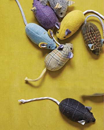 Treat a kitty to a game of cat and mouse with a few dapper toys. There's no mistaking these critters for the real thing -- they're constructed from brightly colored suiting and shirting fabric    Read more at Marthastewart.com: Menswear Mouse Toy- Martha Stewart Pets