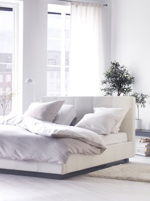 The sleek sophistication of the FOLLDAL white leather bed will make any bedroom fit for a movie star.