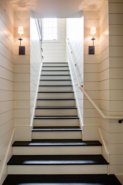 Wood paneling adds rustic charm to this beautiful staircase. #staircase #shiplap