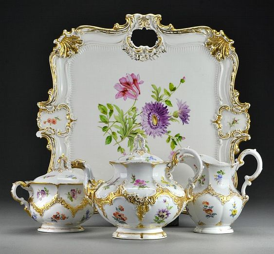 To include a tray, teapot, covered sugar and a creamer, decorated with floral…