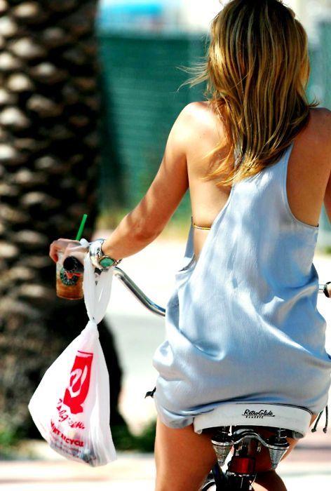 Kate Hudson rides a bike