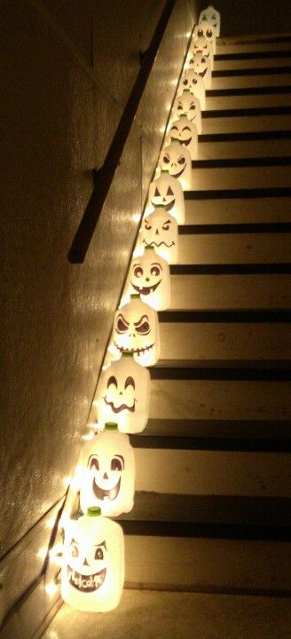 I did this for my apartment stairs. Fun and cheap Halloween decor. Use milk or water gallons. Draw Jack O Lantern faces. Puncture a criss cross hole in the back and insert Christmas lights. Fun to do with kids!