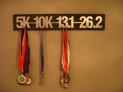 Running medal display broken into distances.|   do them on separate boards to…