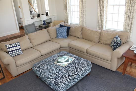 """Her coffee table is a large tufted custom upholstered ottoman in our """"SIMB"""" (color way navy) leopard print fabric. http://www.ufabstore.com/fabrics/animal/print/simb-navy.html#.VUzyw6aH7gN"""