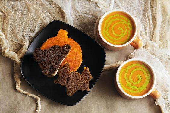 Halloween Grilled Cheese Sandwiches & Witches Brew Soup by Denise Torres Awesome idea for a fun lunch! Use your favorite tomato soup & put pesto sauce in squeeze bottle (mustard/ketchup bottles) to add the swirl... Holiday cookie cutters make cat, bat & pumpkin shaped sandwiches (grill whole sandwiches, then cut into shapes) But, to include kids in prep pre-cut asst bread & cheese slices & let them make their own combinations... Optional White bread for Ghosts & Pumpernickel Witches: