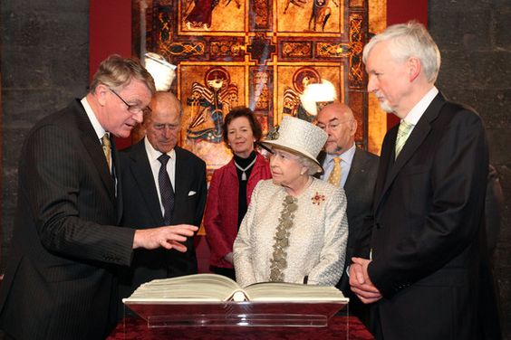 Prince Philip, Duke of Edinburgh and Queen Elizabeth II are shown a facsimile of the Book of Kells by the Provost of Trinity College Dublin Dr. John Hegarty, Librarian Robin Adams, and Chancellor of the University Dr. Mary Robinson when they visit Trinity College Dublin on May 17, 2011 in Dublin, Ireland. The Queen's visit, accompanied by The Duke of Edinburgh