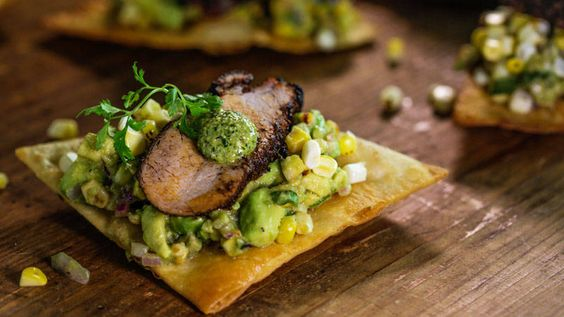 Bobby Flay's Red Chile Rubbed Pork on Tortilla Chips with Avocado Relish and Jalapeño Pesto