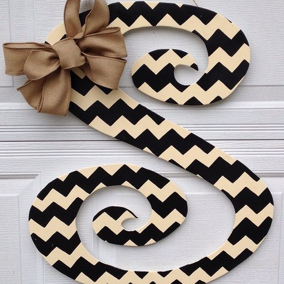 "Out chevron curly letters measure approximately 24"" x 28"". Topped with a sweet burlap bow ....$40"