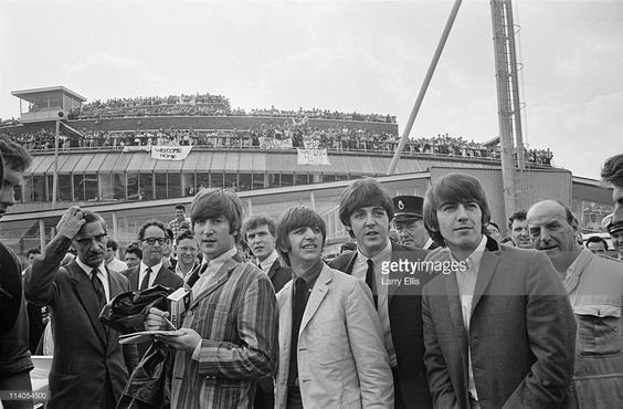 30th July 1964. The Beatles arrive at London Airport after a flight from Stockholm in Sweden.