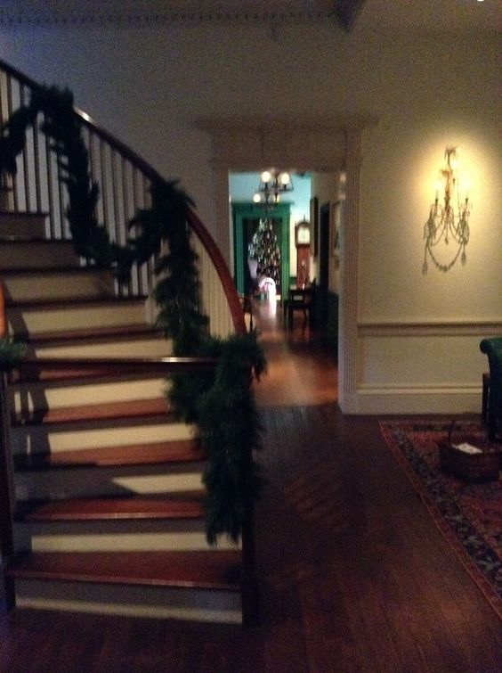Second floor Montmorenci staircase. Looking down the hallway, one can see a Christmas tree in the library    #winterthur