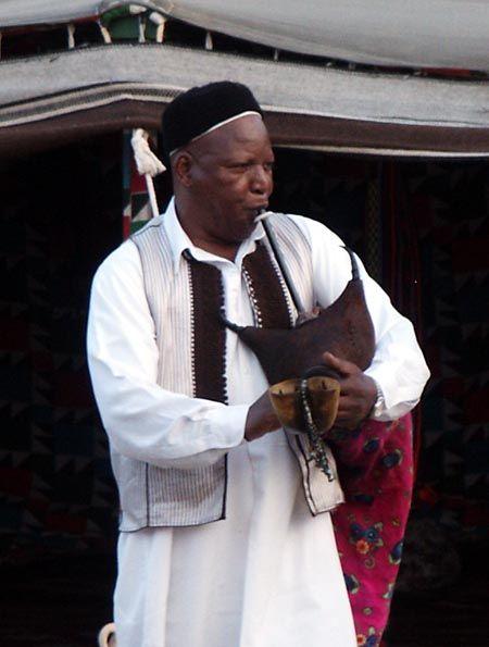 Libyan Berber playing the sacred Zukrah bagpipes.
