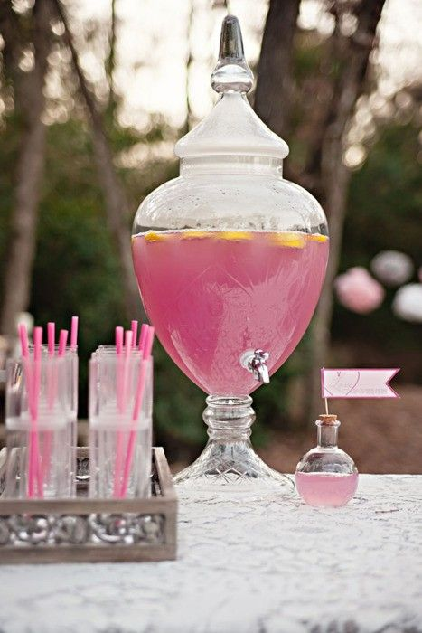 Girly Beer - 6 pack of Beers (I prefer to use Corona Light)  1 can frozen Pink Lemonade concentrate  Vodka    Fill your punch bowl or drink jar with ice, pour in the beers, add the lemonade concentrate and stir (TIP: Leave your lemonade sitting out for a bit before mixing up this drink, if it's a little defrosted, it will stir in easier). Fill the empty lemonade can with vodka, stir in and enjoy!