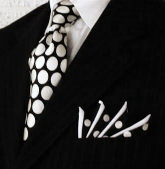 Polka dots  Somehow, printed tie and pocket square on the black pinstripe is both subtle and striking  Custom Pocket Squares at http://www.PocketSquareZ.com: