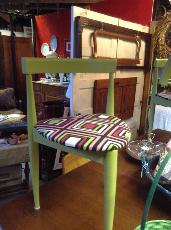 Three legged chair with some new retro fabric.