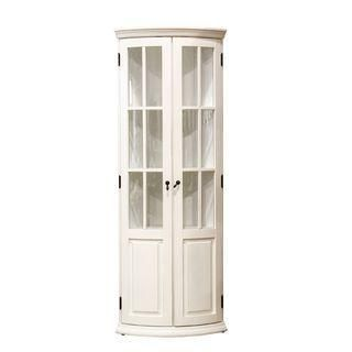 This white corner cabinet features glass fronted doors, four ...