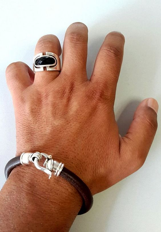 I love this Designer, the ring is super stylish and the leather bracelet is nothing but simply beautiful and very masculine....