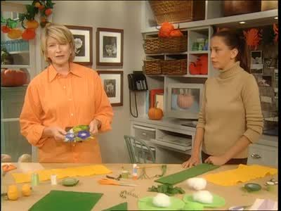 Martha Stewart and her guest Julia Levine create crepe paper Halloween costumes, dressing young children as pea pods, pumpkins and flowers.