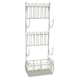 "Crafted from metal and showcasing a scrolling wire design, this versatile wall rack is perfect for stowing spices and towels in the kitchen or mail in the entryway.  Product: Wall rackConstruction Material: MetalColor: Antiqued whiteFeatures: Four hooksDimensions: 24"" H x 9"" W x 5.5"" D"