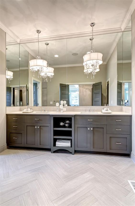 master vanity with full length mirror grey cabinetry and crystal and chrome lighting accents bathroom pendant lighting double vanity