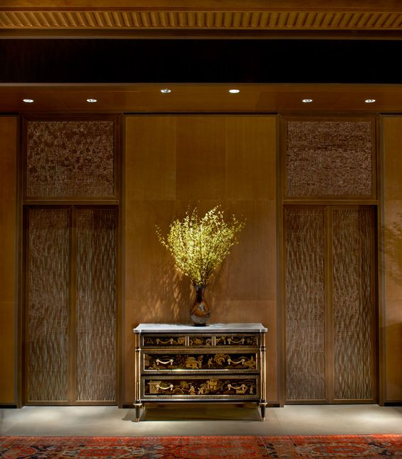 Suzanne Lovell, Inc. - Skyline Penthouse, Entry: The elevator gates are comprised of copper filament woven on an Aubusson loom outside of Paris and maintain security for the 7,500 sq. ft. space.
