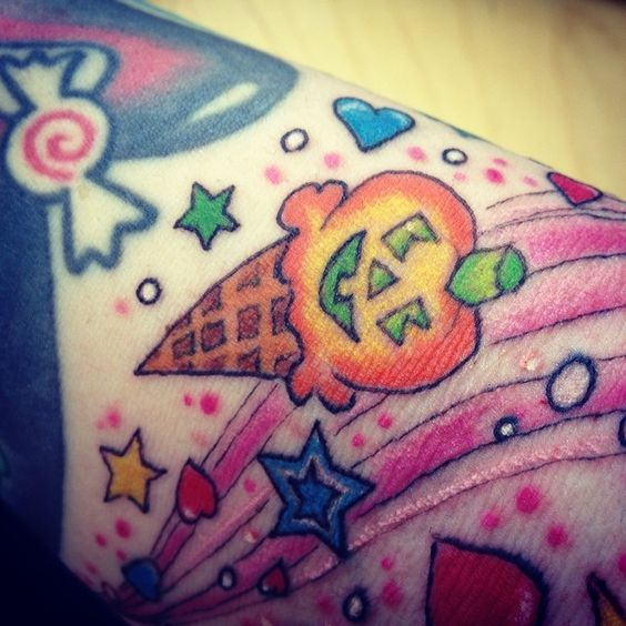 Part of my new #LisaFrankTattoo #loveit #lisafrank #icecream #halloween #tattoo #cute #newtattoo #spooky