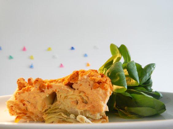 quiche van kikkererwten, tofu, zongedroogde tomaten, ui en artisjokharten