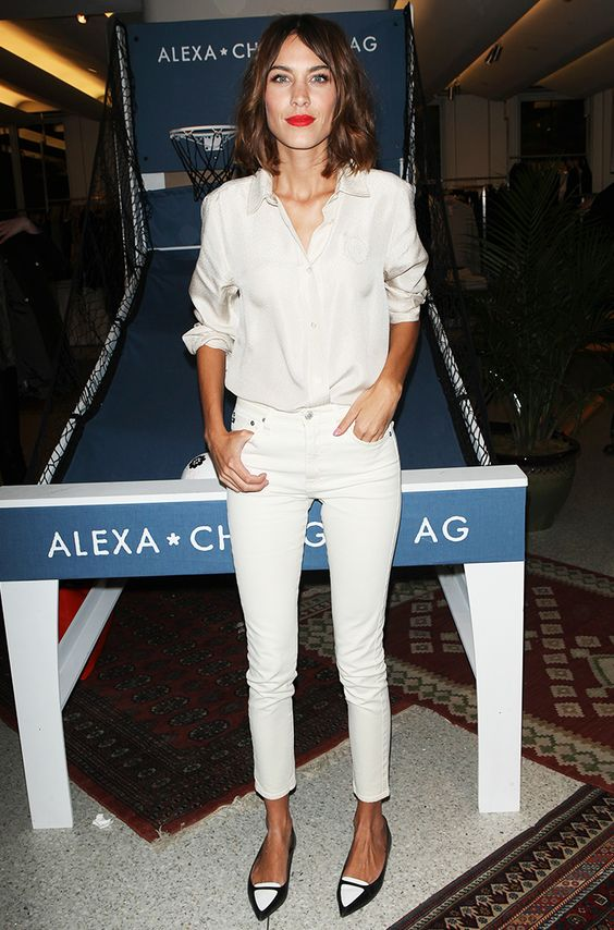 Alexa Chung wears a white button-down shirt with white cropped skinny jeans and black and white shoes: