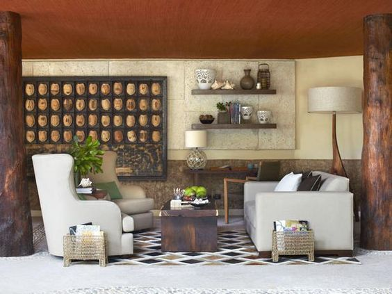 A mix of #rustic #wood, exotic #accessories and #streamlined #furniture creates an inviting outdoor #library.