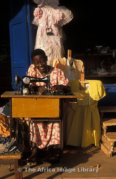 woman sowing clothes in the market, Jinja, Uganda
